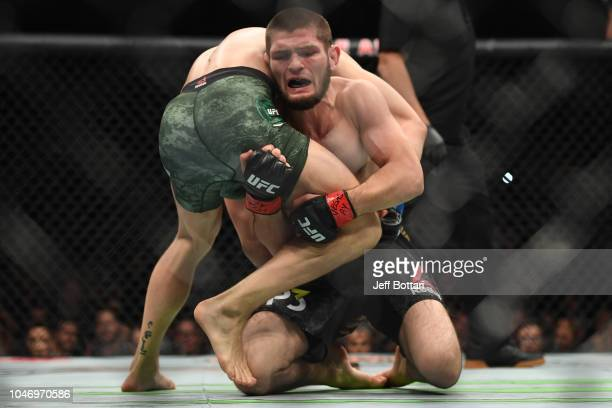 Khabib Nurmagomedov of Russia attempts to takedown Conor McGregor of Ireland in their UFC lightweight championship bout during the UFC 229 event...