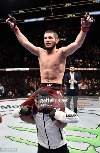 Khabib Nurmagomedov of Russia celebrates after a dominating performance over Al Iaquinta in their lightweight title bout during the UFC 223 event...