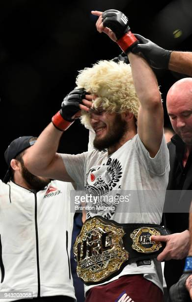 Khabib Nurmagomedov of Russia celebrates after his dominating victory over Al Iaquinta in their lightweight title bout during the UFC 223 event...