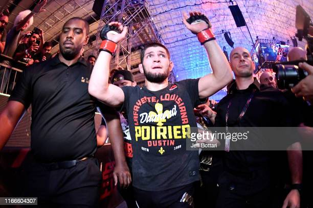Khabib Nurmagomedov of Russia celebrates his submission victory over Dustin Poirier in their lightweight championship bout during UFC 242 at The...