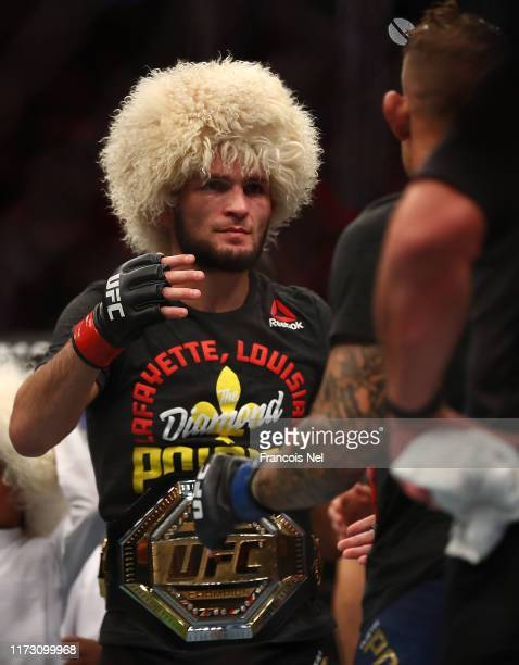 Khabib Nurmagomedov of Russia celebrates his submission victory over Dustin Poirier Dustin of United States in their Lightweight Title Bout during...