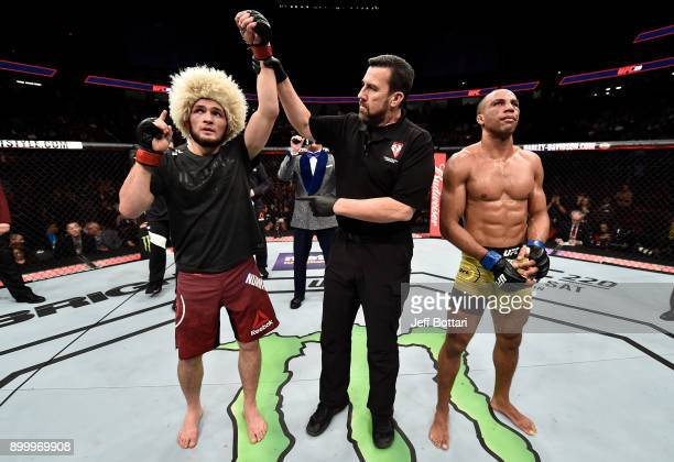 Khabib Nurmagomedov of Russia celebrates his unanimousdecision victory over Edson Barboza in their lightweight bout during the UFC 219 event inside...