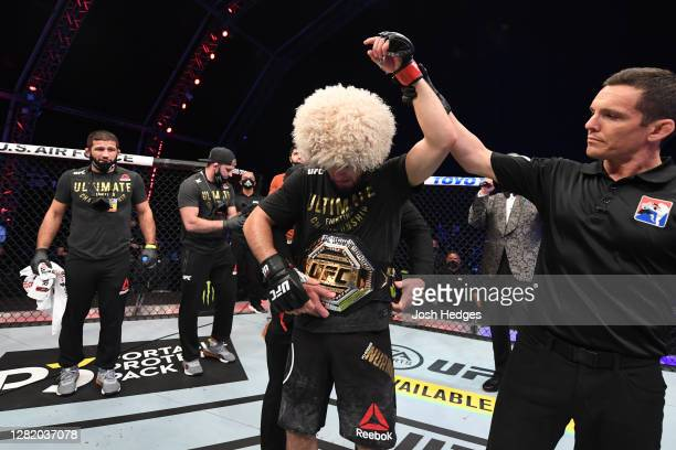 Khabib Nurmagomedov of Russia celebrates his victory over Justin Gaethje in their lightweight title bout during the UFC 254 event on October 25, 2020...