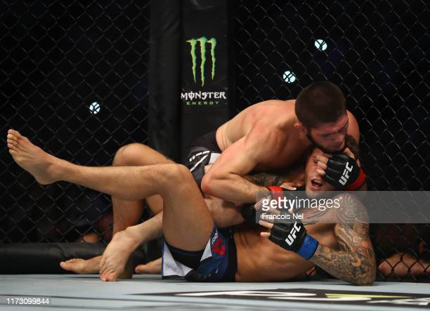 Khabib Nurmagomedov of Russia compete against Dustin Poirier of United States in their Lightweight Title Bout during the UFC 242 event at The Arena...