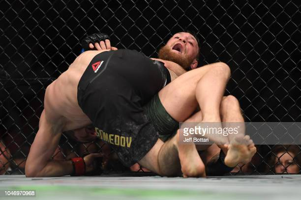 Khabib Nurmagomedov of Russia controls the body of Conor McGregor of Ireland in their UFC lightweight championship bout during the UFC 229 event...