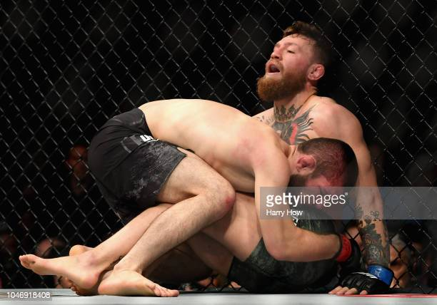 Khabib Nurmagomedov of Russia holds down Conor McGregor of Ireland in their UFC lightweight championship bout during the UFC 229 event inside TMobile...