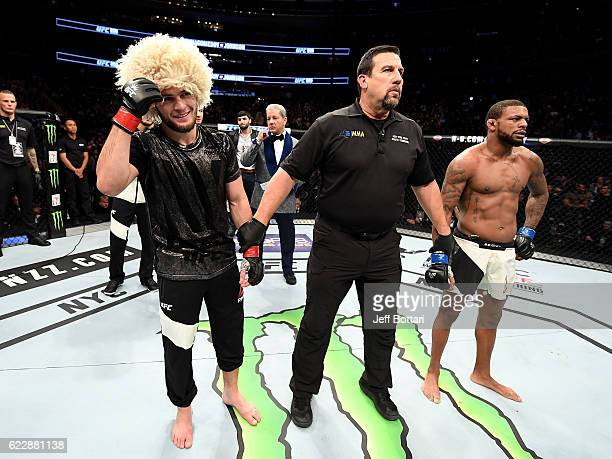 Khabib Nurmagomedov of Russia is awarded victory by KO over Michael Johnson of the United States in their lightweight bout during the UFC 205 event...