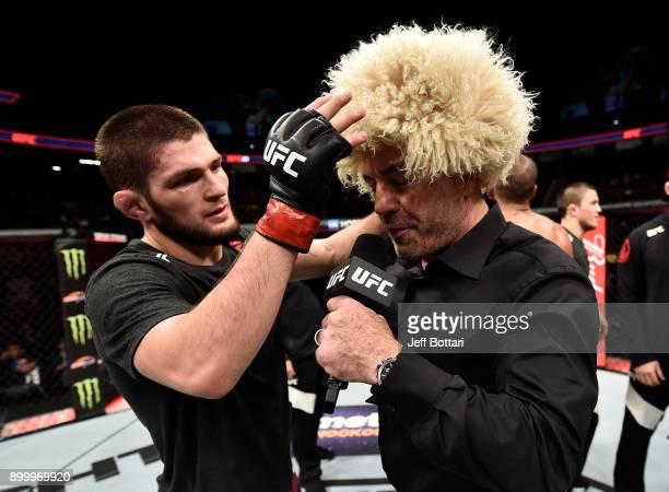 Khabib Nurmagomedov of Russia is interviewed by Joe Rogan after his unanimousdecision victory over Edson Barboza in their lightweight bout during the...