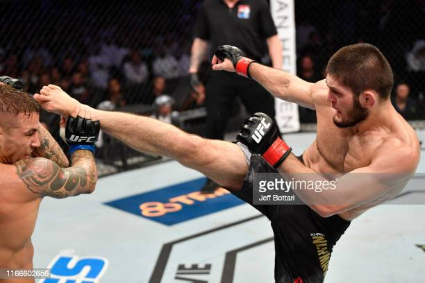 Khabib Nurmagomedov of Russia kicks Dustin Poirier in their lightweight championship bout during UFC 242 at The Arena on September 7 2019 in Yas...