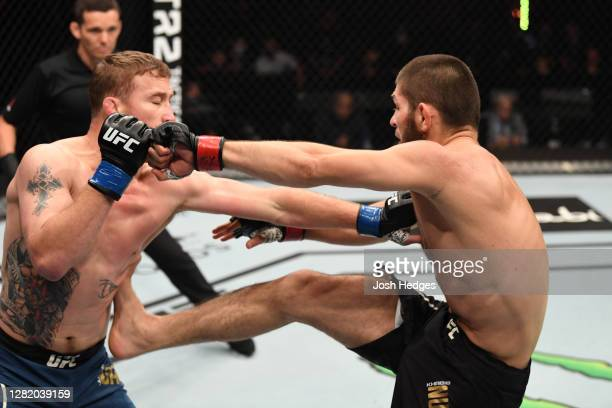 Khabib Nurmagomedov of Russia kicks Justin Gaethje in their lightweight title bout during the UFC 254 event on October 25, 2020 on UFC Fight Island,...