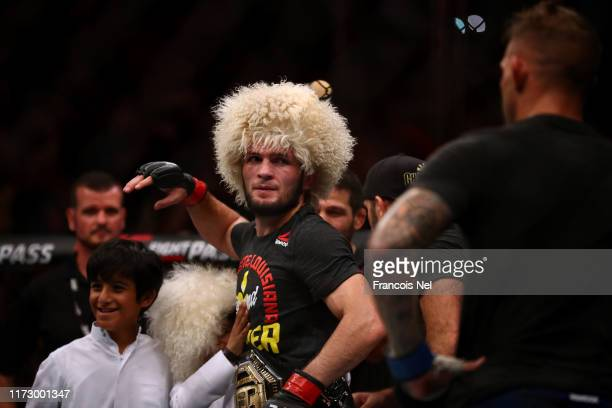 Khabib Nurmagomedov of Russia looks an after beating Dustin Poirier of United States in their Lightweight Title Bout during the UFC 242 event at The...