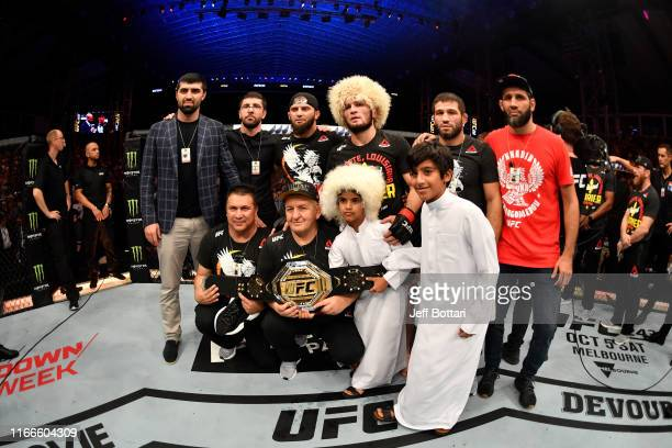Khabib Nurmagomedov of Russia poses for a photo with his team after his submission victory over Dustin Poirier in their lightweight championship bout...