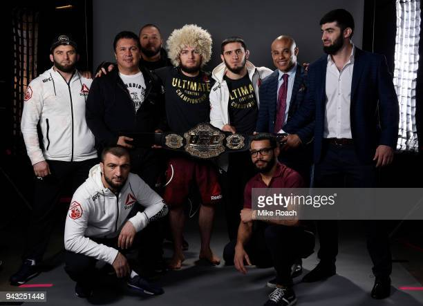 Khabib Nurmagomedov of Russia poses for a portrait backstage with his team after his victory over Al Iaquinta during the UFC 223 event inside...