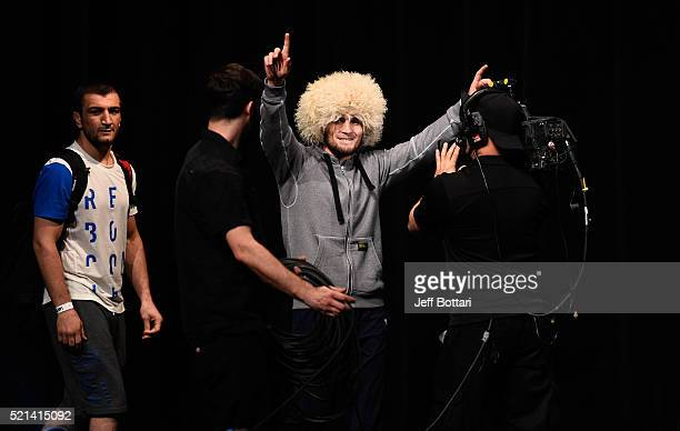 Khabib Nurmagomedov of Russia prepares to step onto the scale during the UFC Fight Night weighin at Ruth Eckerd Hall on April 15 2016 in Clearwater...
