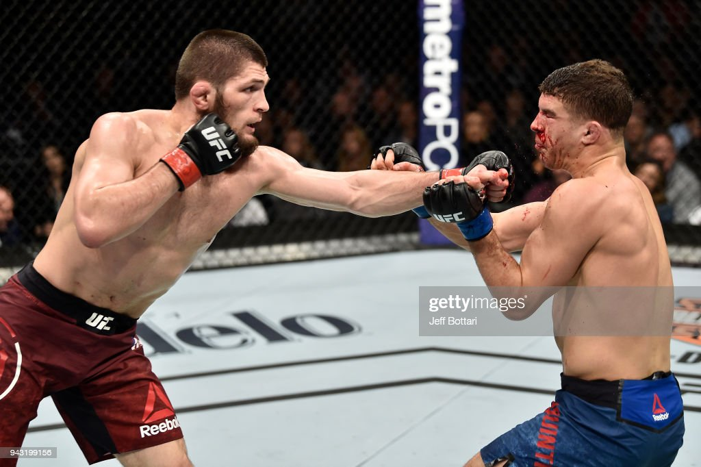 Khabib Nurmagomedov of Russia punches Al Iaquinta in their lightweight title bout during the UFC 223 event inside Barclays Center on April 7, 2018 in Brooklyn, New York.