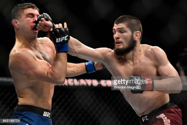 Khabib Nurmagomedov of Russia punches Al Iaquinta in their lightweight title bout during the UFC 223 event inside Barclays Center on April 7 2018 in...