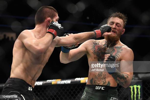 Khabib Nurmagomedov of Russia punches Conor McGregor of Ireland in their UFC lightweight championship bout during the UFC 229 event inside TMobile...