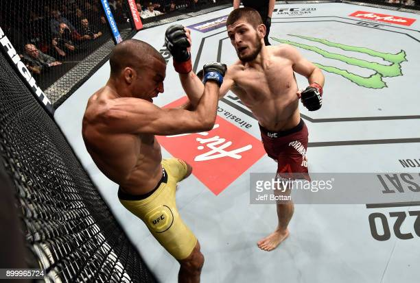 Khabib Nurmagomedov of Russia punches Edson Barboza of Brazil in their lightweight bout during the UFC 219 event inside TMobile Arena on December 30...