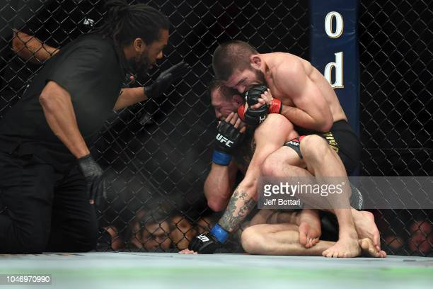 Khabib Nurmagomedov of Russia submits Conor McGregor of Ireland in their UFC lightweight championship bout during the UFC 229 event inside TMobile...
