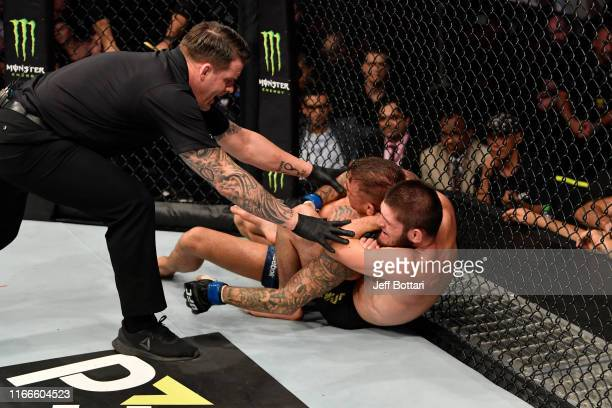 Khabib Nurmagomedov of Russia submits Dustin Poirier in their lightweight championship bout during UFC 242 at The Arena on September 7 2019 in Yas...