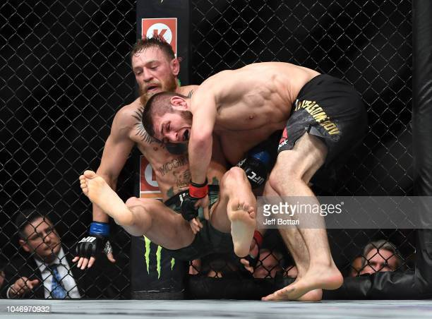 Khabib Nurmagomedov of Russia takes down Conor McGregor of Ireland in their UFC lightweight championship bout during the UFC 229 event inside TMobile...