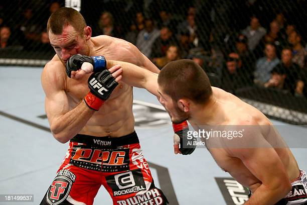 Khabib Nurmagomedov punches Pat Healy in their UFC lightweight bout at the Air Canada Center on September 21 2013 in Toronto Ontario Canada
