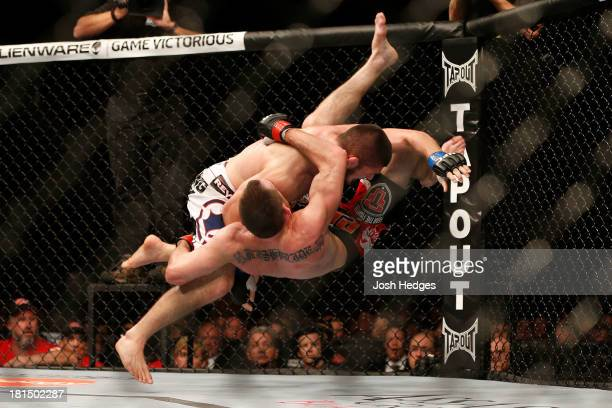 Khabib Nurmagomedov takes down Pat Healy in their UFC lightweight bout at the Air Canada Center on September 21 2013 in Toronto Ontario Canada