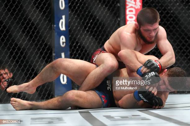 Khabib Nurmagomedov throws a punch at Al Iaquinta during their UFC lightweight championship bout at UFC 223 at Barclays Center on April 7 2018 in New...