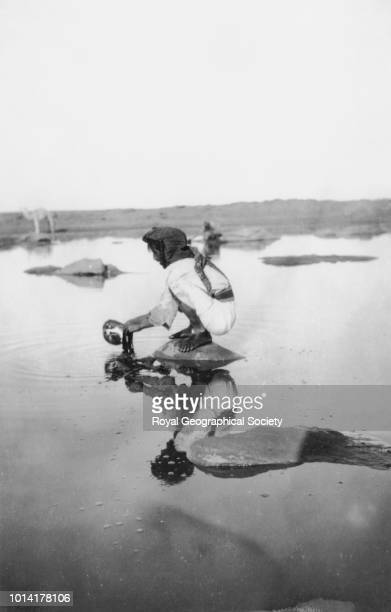 Khabra Masawid Man filling waterskin This photograph was taken during Gertrude Bell's journey from Tubaiq to Khabra Masawid She mentions visiting...