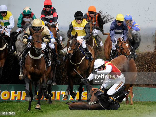 Khachaturian and Jason Maguire fall during The matalancouk Mildmay Novices' Steeple Chase at Aintree racecourse on April 09 2010 in Liverpool England