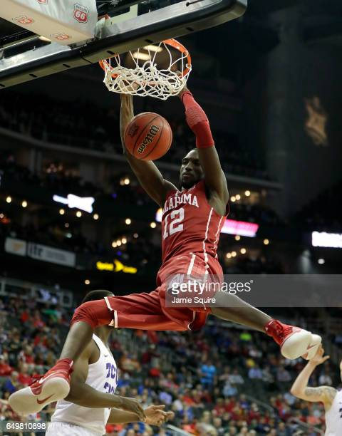 Khadeem Lattin of the Oklahoma Sooners dunks during the first round game of the Big 12 Basketball Tournament against the TCU Horned Frogs at the...
