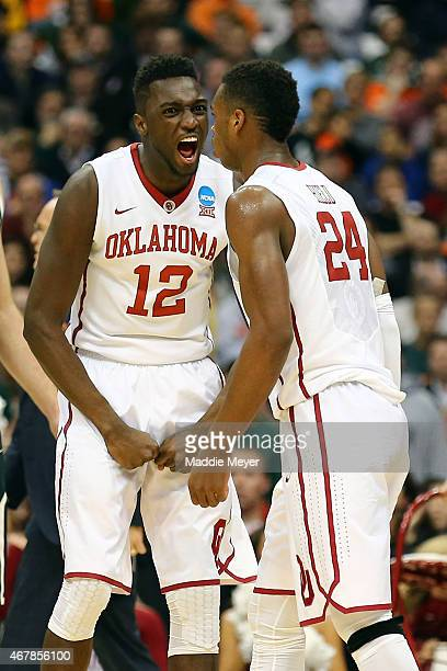 Khadeem Lattin of the Oklahoma Sooners reacts with teammate Buddy Hield after a basket in the second half of the game against the Michigan State...