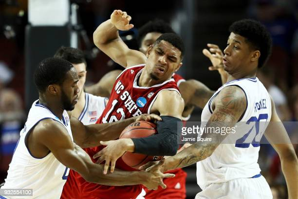 Khadeen Carrington and Desi Rodriguez of the Seton Hall Pirates pressure Allerik Freeman of the North Carolina State Wolfpack in the second half...