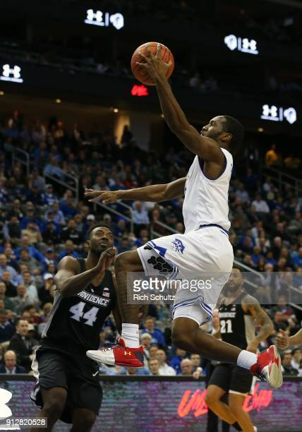 Khadeen Carrington of the Seton Hall Pirates attempts a layup as Isaiah Jackson of the Providence Friars defends during the second half of a game at...