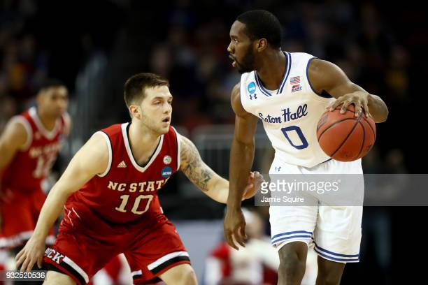 Khadeen Carrington of the Seton Hall Pirates dribbles the ball while being guarded by Braxton Beverly of the North Carolina State Wolfpack in the...