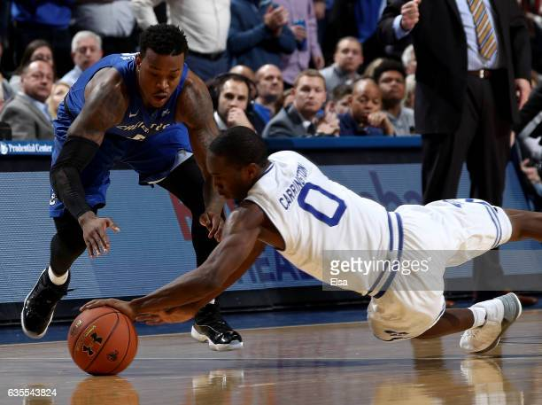Khadeen Carrington of the Seton Hall Pirates steals the ball from Marcus Foster of the Creighton Bluejays in the final minutes of the game on...