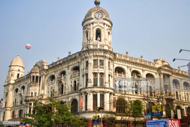 khadi udyog building with clock tower esplanade at calcutta kolkata, west bengal, india - khadi photos et images de collection