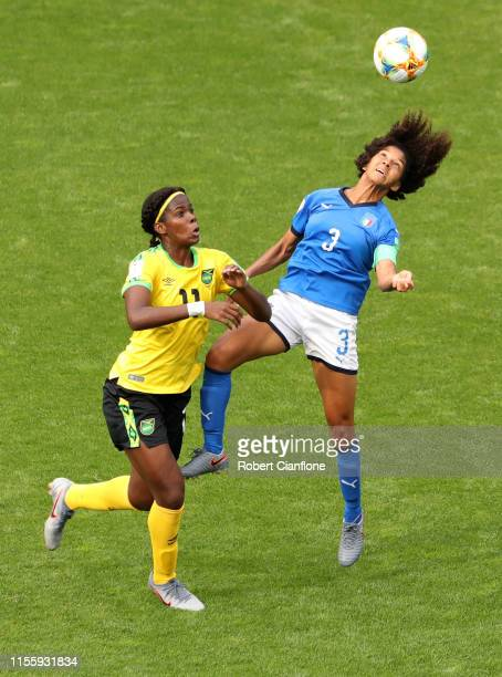Khadija Shaw of Jamaica competes for a header with Sara Gama of Italy during the 2019 FIFA Women's World Cup France group C match between Jamaica and...