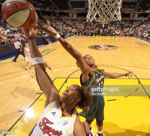 Khadijah Whittington of the Indiana Fever battles Yolanda Griffth of the Seattle Storm at Conseco Fieldhouse on July 18 2008 in Indianapolis Indiana...