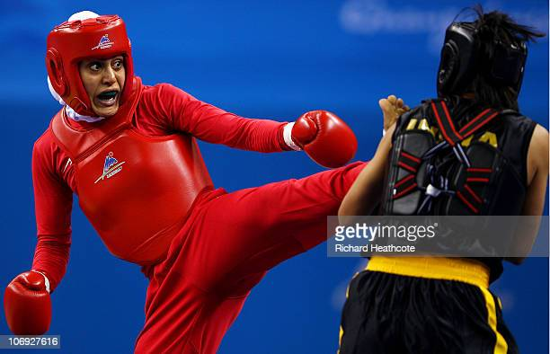 Khadijeh Azadpour of Iran and Sandhyra Wangkhem of India compete in the Women�s 60kg Sanshou Wushu Final during day five of the 16th Asian Games...