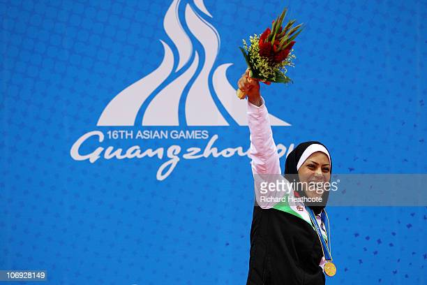 Khadijeh Azadpour of Iran celebrates winning the Gold medal in in the Women's 60kg Sanshou Wushu during day five of the 16th Asian Games Guangzhou...