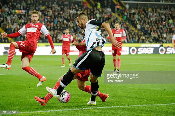 Khadim Ali Adnan of Udinese Calcio competes with Cristian Zaccardo of Carpi FC during the Serie A match between Udinese Calcio and Carpi FC at Stadio...