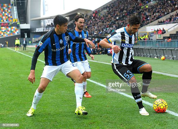 Khadim Ali Adnan of Udinese Calcio competes with Marcelo Estigarribia and Luca Cigarini of Atalanta BC during the Serie A match between Udinese...