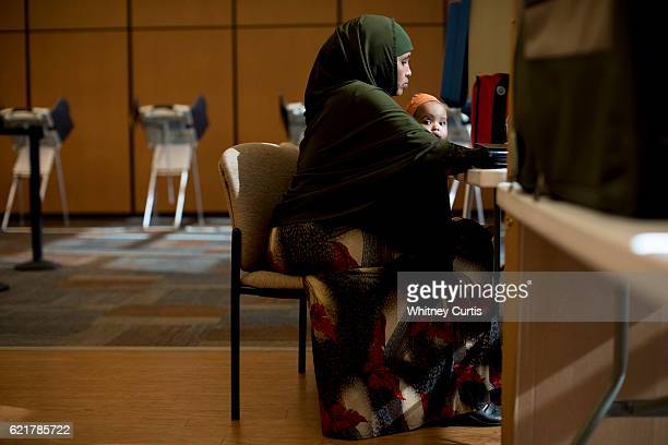 Khadra Guled holds Mushtaq her friend's oneyearold daughter as she prepares to cast her ballot on November 8 2016 in Olathe Kansas After a...