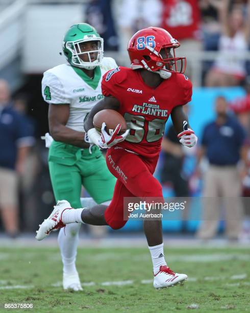 Khairi Muhammad of the North Texas Mean Green pursues Willie Wright of the Florida Atlantic Owls as he runs with the ball for a touchdown on October...