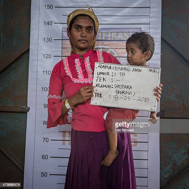 Khairul Amin a Rohingya migrant child carried by his mother poses for identification purposes at a temporary shelter on May 18 2015 in Kuala Langsa...