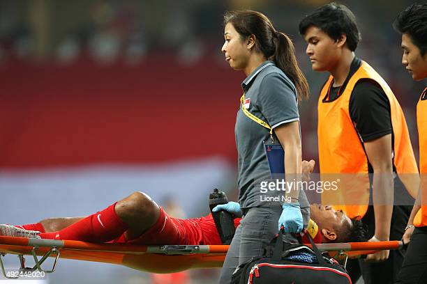 Khairul Amri of Singapore is carried off on a stretcher in the first half during the FIFA 2018 World Cup Qualifier match between Singapore and...