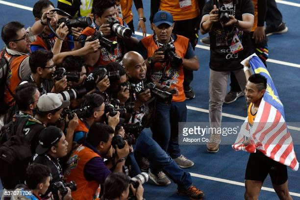 Khairul Hafiz of Malaysia celebrates after winning the Gold Medal as he poses for photographs during the Men100m Final at Bukit Jalil National...