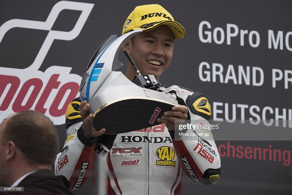 Khairul Idham Pawi of Malaysia and Honda Team Asia celebrates the victory on the podium at the end of the Moto3 race during the MotoGp of Germany - Race at Sachsenring Circuit on July 17, 2016 in Hohenstein-Ernstthal, Germany.