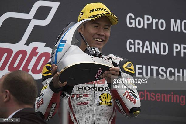 Khairul Idham Pawi of Malaysia and Honda Team Asia celebrates the victory on the podium at the end of the Moto3 race during the MotoGp of Germany...